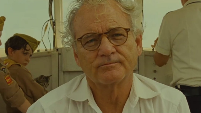 Moonrise Kingdom - Mr. Bishop Bill Murray on boat with tabby kitten held by Khaki Scout in background