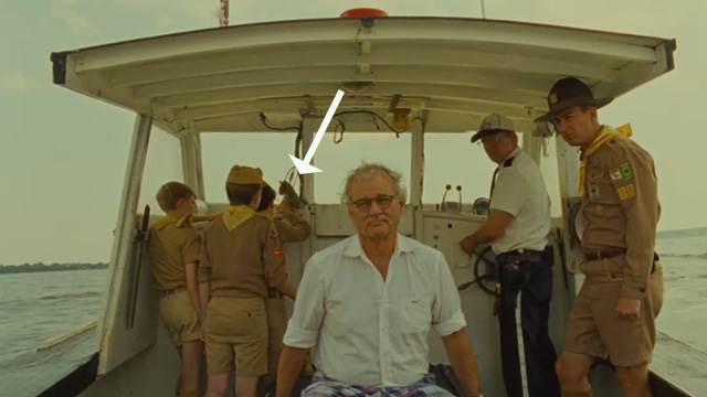 Moonrise Kingdom - Khaki Scouts playing with tabby kitten on boat behind Mr. Bishop Bill Murray