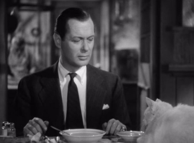 Mr. and Mrs. Smith - closer of David Robert Montgomery looking at white cat on table
