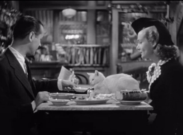 Mr. and Mrs. Smith - David Robert Montgomery offering white cat on table bowl of soup with Ann Carole Lombard