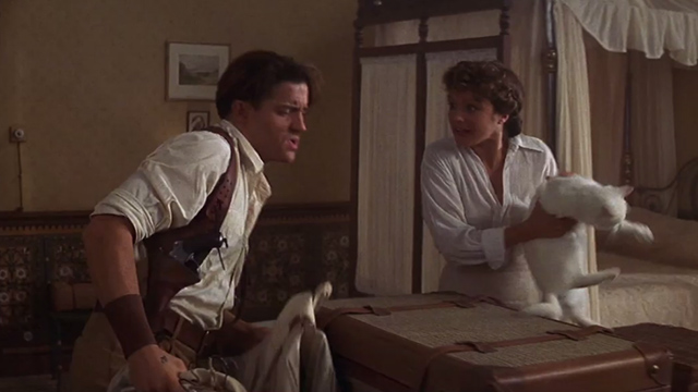 The Mummy - Evelyn Rachel Weisz snatches white cat from suitcase before Rick Brendan Fraser can open it