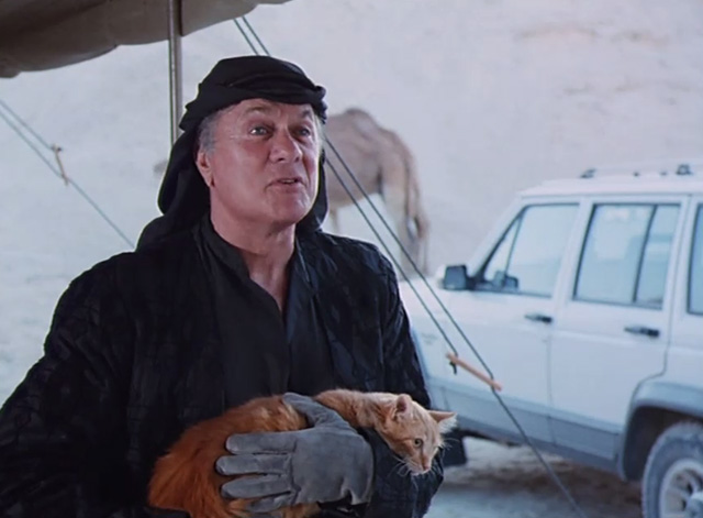 The Mummy Lives - Dr. Mohassid Tony Curtis holding long haired ginger tabby cat