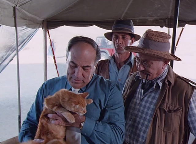 The Mummy Lives - Lord Maxton Jacques Cohen holding long haired ginger tabby cat with cronies