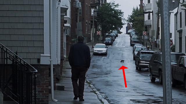 Mystic River - cat crossing street ahead of Dave Tim Robbins
