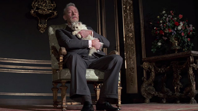 Never Say Never Again - Blofeld Max von Sydow on chair holding white Angora cat