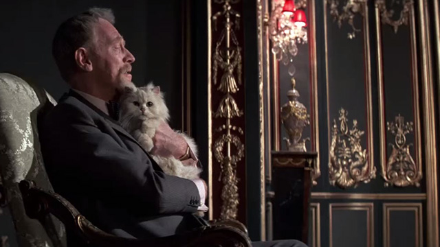 Never Say Never Again - Blofeld Max von Sydow on chair holding white Angora cat closer