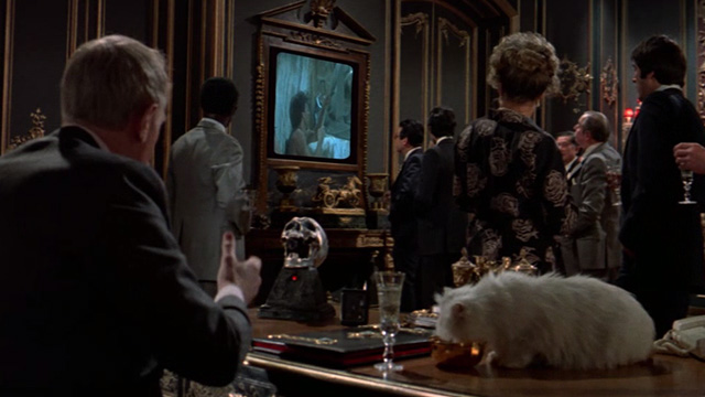 Never Say Never Again - Blofeld Max von Sydow at desk with white Angora cat eating