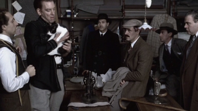 Novecento - 1900 - Attila Donald Sutherland holding tuxedo cat in tailor shop