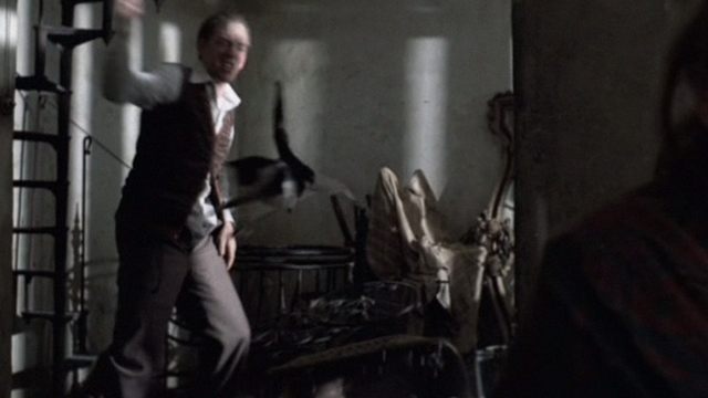 Novecento - 1900 - Attila Donald Sutherland flinging tuxedo cat across room