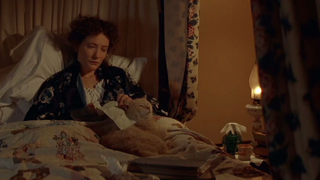 Oscar and Lucinda - Lucinda Cate Blanchett in bed with orange tabby cat and letter
