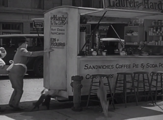 Pack Up Your Troubles - numerous ats leaping out of lunch wagon owned by Laurel and Hardy