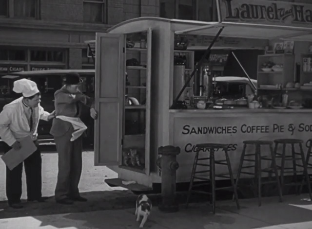 Pack Up Your Troubles - numerous cats leaping out of lunch wagon owned by Laurel and Hardy