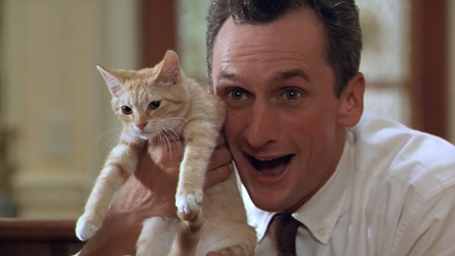 Paulie - Marie's father Matt Craven holding up ginger tabby kitten
