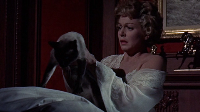 Portrait in Black - Sheila Lana Turner picking up Siamese cat Rajah