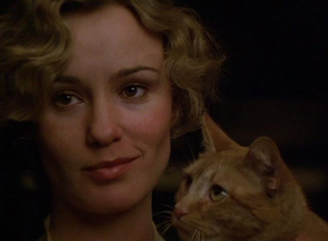The Postman Always Rings Twice 1981 - close up of orange tabby cat and Cora Jessica Lange