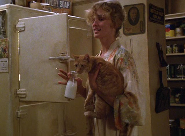 The Postman Always Rings Twice 1981 - Cora Jessica Lange and orange tabby cat getting bottle of milk