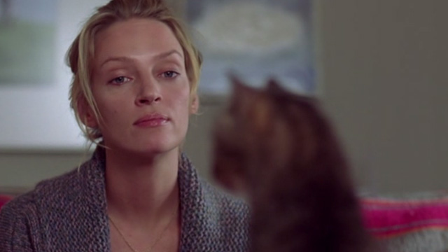 Prime - Rafi Uma Thurman looking at tabby cat