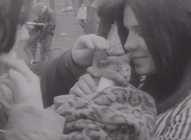 Protests Galore newsreel - two girls with cat at love-in in Detroit