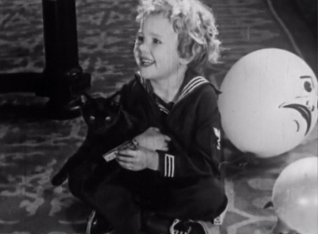 Raisin' Trouble - little boy holding black cat
