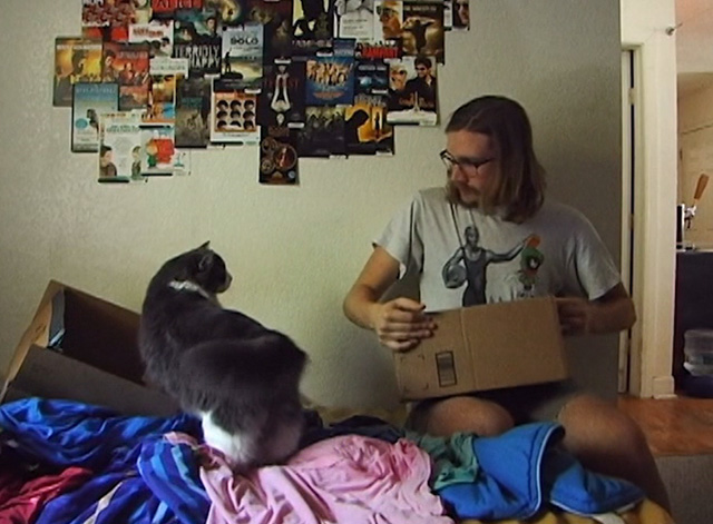 Ramblin' Freak - Cat on bed with Parker Smith