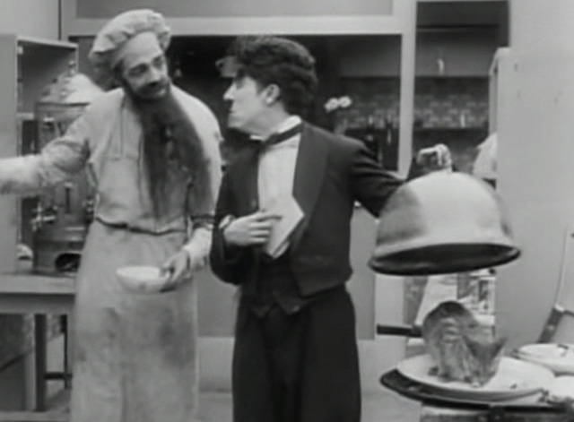 The Rink - cook Albert Austin and waiter Charlie Chaplin with cat about to be covered by cloche