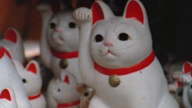 Sans Soleil - maneki-neko beckoning cats at temple