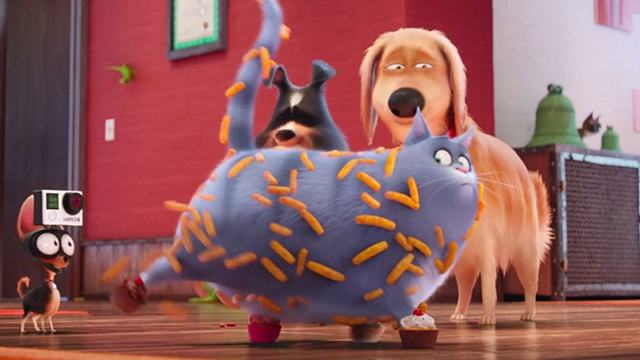 The Secret Life of Pets - gray tabby Chloe covered in Cheetohs with cupcakes on paws