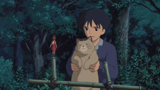 The Secret World of Arrietty - Sho holding up Niya cat to Arrietty
