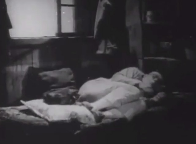 Shadows - Yen Sing Lon Chaney curling up on bed with Bengal tabby cat on cushion at feet