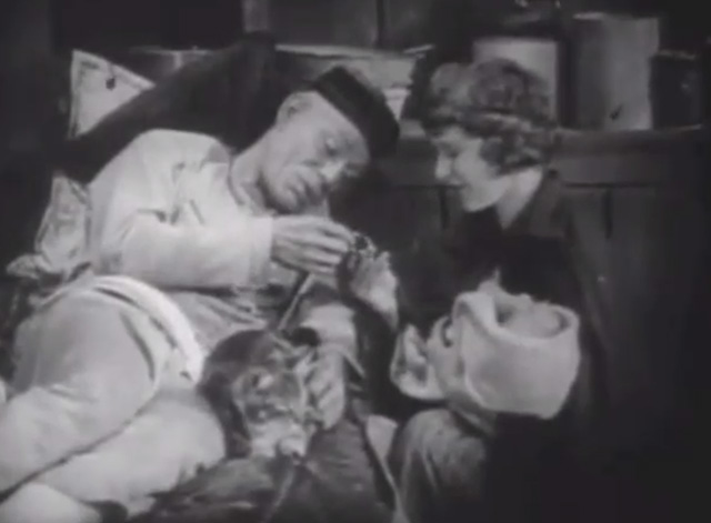 Shadows - Yen Sing Lon Chaney lying on death bed with Bengal tabby cat at his side giving Sympathy Marguerite De La Motte Minister a gift