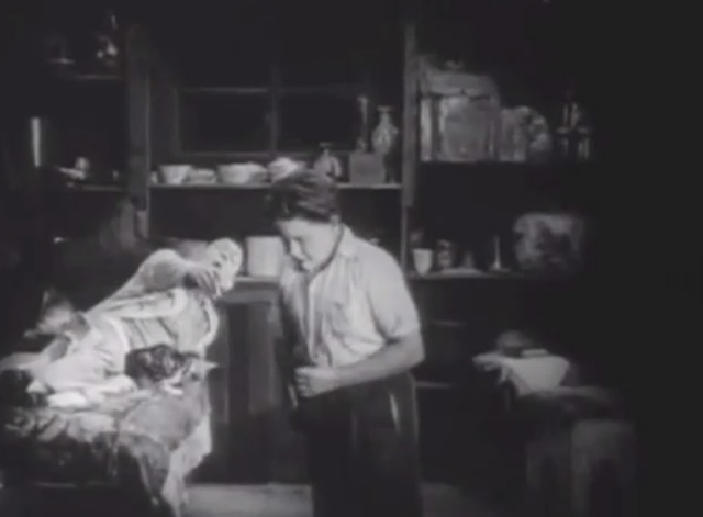 Shadows - Yen Sing Lon Chaney lying on death bed with Bengal tabby cat calling to boy Buddy Messenger