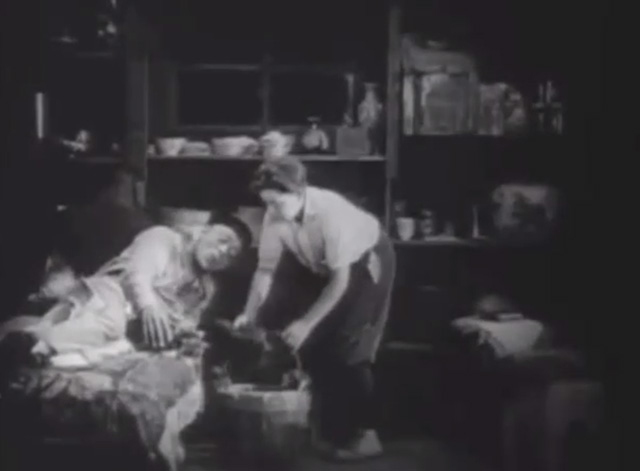 Shadows - Yen Sing Lon Chaney lying on death bed with Bengal tabby cat and boy Buddy Messenger