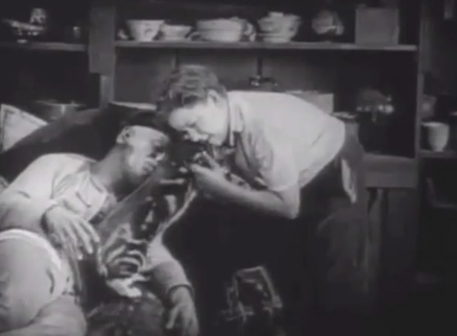 Shadows - Yen Sing Lon Chaney lying on death bed with boy Buddy Messenger lifting away Bengal tabby cat
