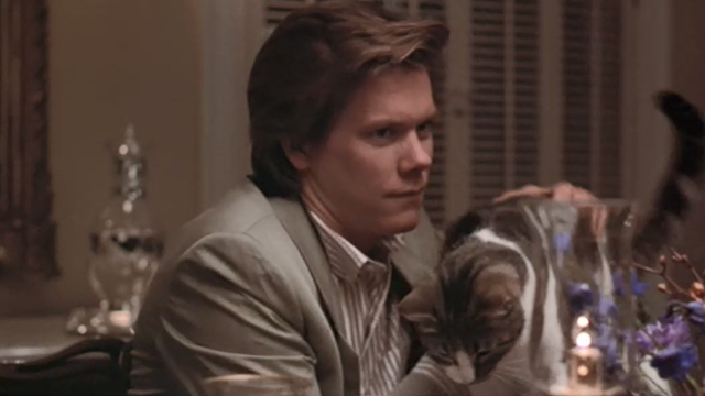 She's Having a Baby - Jake Kevin Bacon picking cat up from table to set down