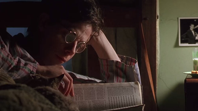 Shine - young David Helfgott Noah Taylor reading in bed with cat