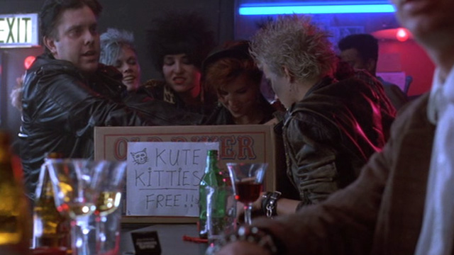 Sid and Nancy - punk rock followers gathered around box of kittens