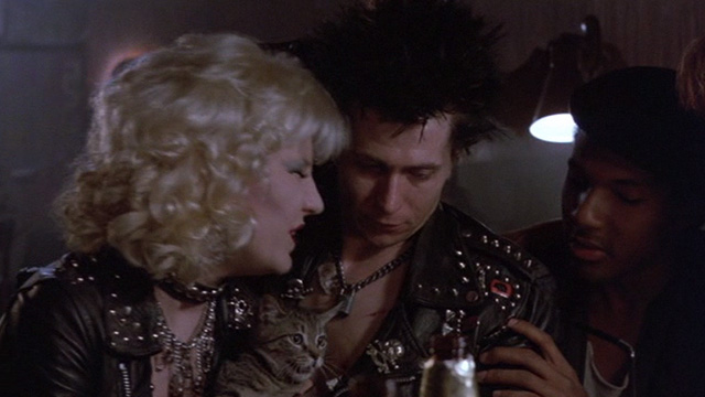 Sid and Nancy - Nancy Chloe Webb with tabby kitten at table with Sid Gary Oldman