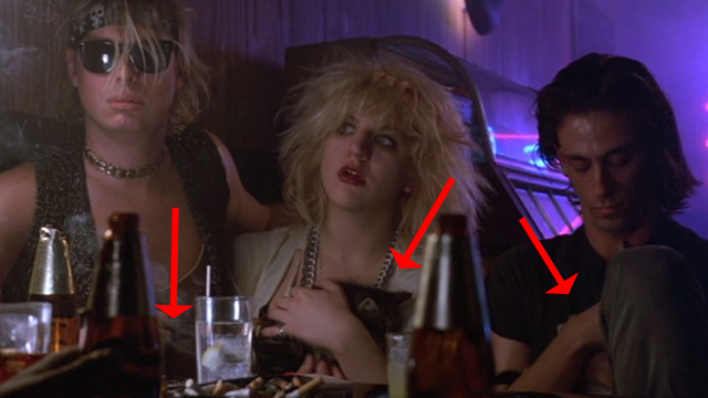 Sid and Nancy - punk rockers Gretchen Courtney Love at table with kittens