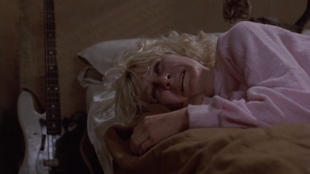 Sid and Nancy - Nancy Chloe Webb crying on bed with tabby kitten behind her