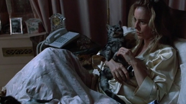 Six Degrees of Separation - Ouisa Stockard Channing holding Bengal tabby cat in bed