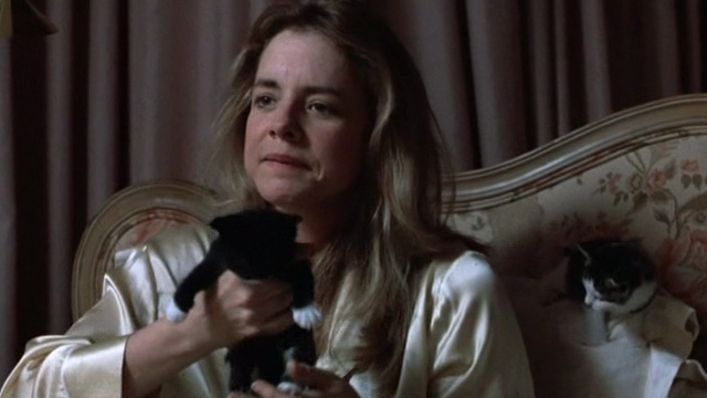 Six Degrees of Separation - Ouisa Stockard Channing in bed with tabby cat and holding tuxedo kitten