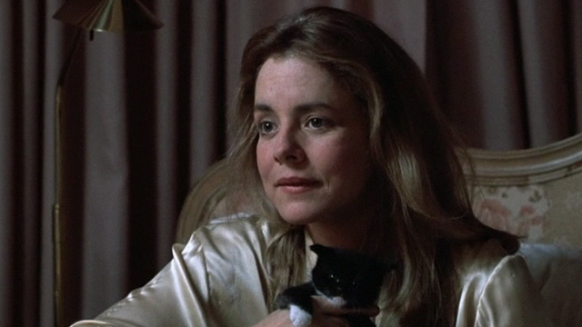 Six Degrees of Separation - Ouisa Stockard Channing in bed holding tuxedo kitten