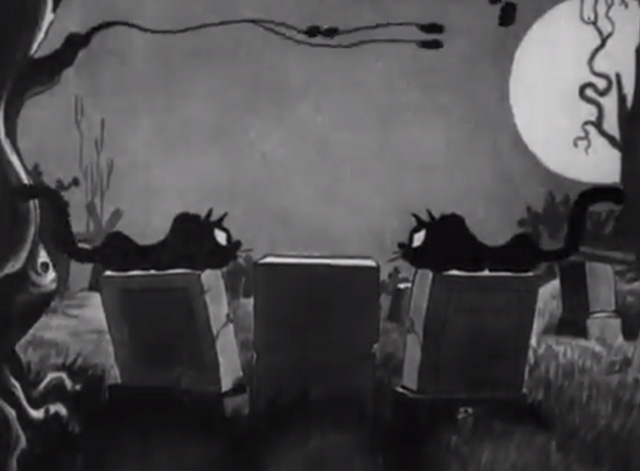 The Skeleton Dance - black cats facing off on tombstones at night