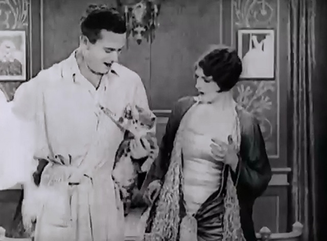 Slipping Wives - Herbert Rawlinson pulls stocking off cat to show Priscilla Dean