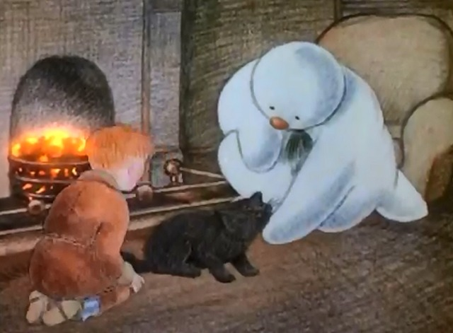 The Snowman - cat being petted by snowman