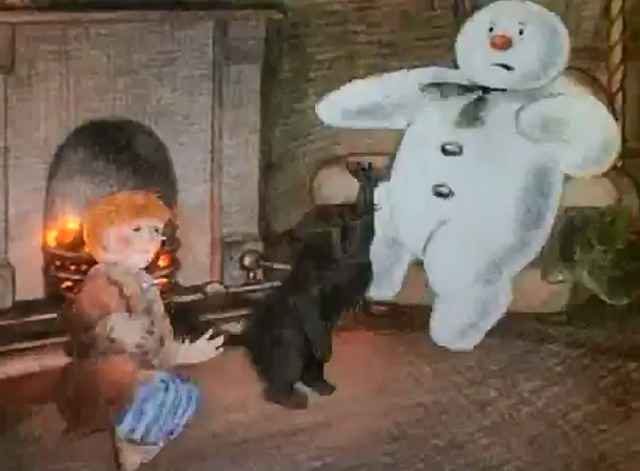 The Snowman - cat scratching at snowman