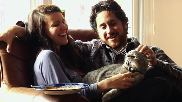 Somm - Brian McClintic and wife Sam playing with their pet cat