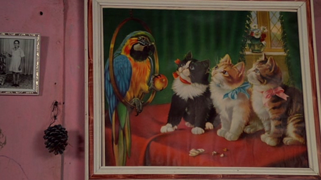 Sorcerer - kitschy painting of kittens and parrot