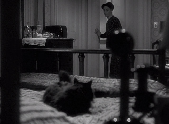 Sorry, Wrong Number - black cat sitting on bed as Ms. Jennings Dorothy Neumann enters