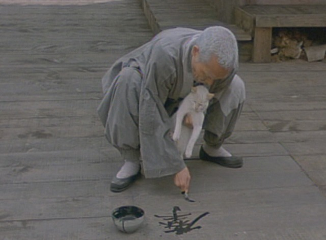 Spring, Summer, Fall, Winter . . . and Spring - old monk uses white cat's tail to paint Chinese characters